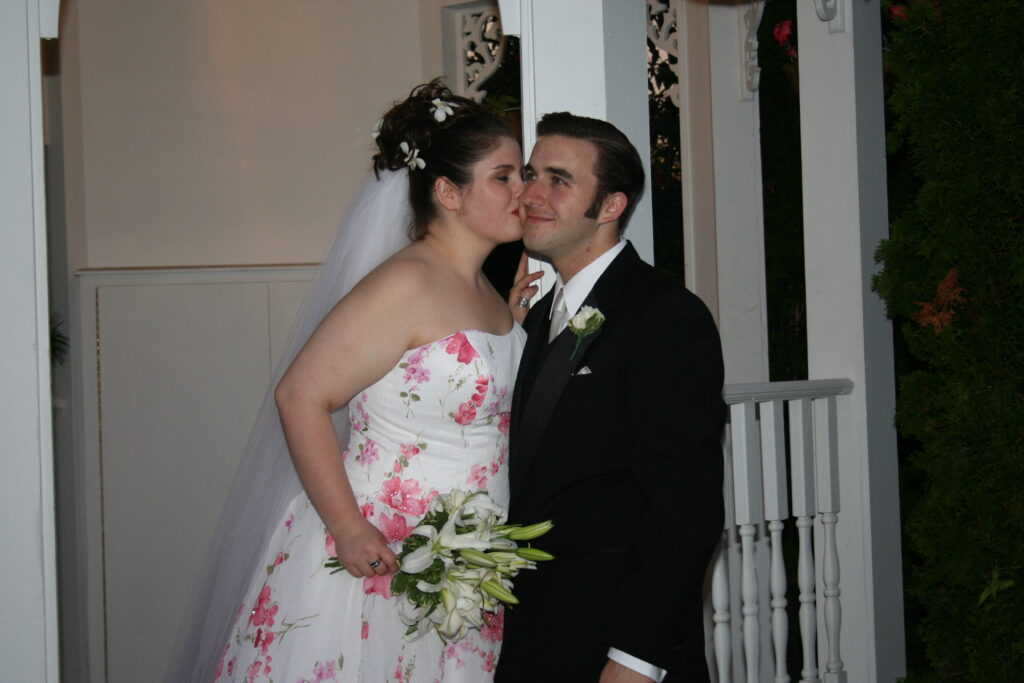 Color photo of two people on their wedding day.