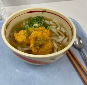 Color photograph of an incredibly delicious bowl of noodle soup from the Doshisha University cafeteria